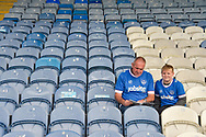 Portsmouth fans young and old reading a programme before kick off during the EFL Sky Bet League 1 match between Portsmouth and Fleetwood Town at Fratton Park, Portsmouth, England on 16 September 2017. Photo by Adam Rivers.