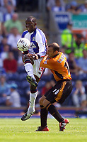 Photo. Jed Wee<br /> Blackburn Rovers v Wolverhampton Wanderers, FA Barclaycard Premiership, Ewood Park, Blackburn. 16/08/2003.<br /> Blackburn's Dwight Yorke (L) is clattered into by Wolves' Colin Cameron.
