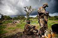 SPLA soliders guard the evacuation of a camp for Central African Republic Refugees fleeing LRA attacks near Tambura ,Western Equatoria on May 13, 2010.  The refugees were transported to the Makpandu refugee camp for safety days before the LRA entered South Sudan and started attacking nearby villages. The SPLA was powerless to stop them.