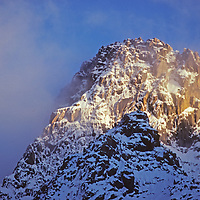 A stormy sunset lights the north face of Mount Sill, above Palisade Glacier in California's Sierra Nevada.