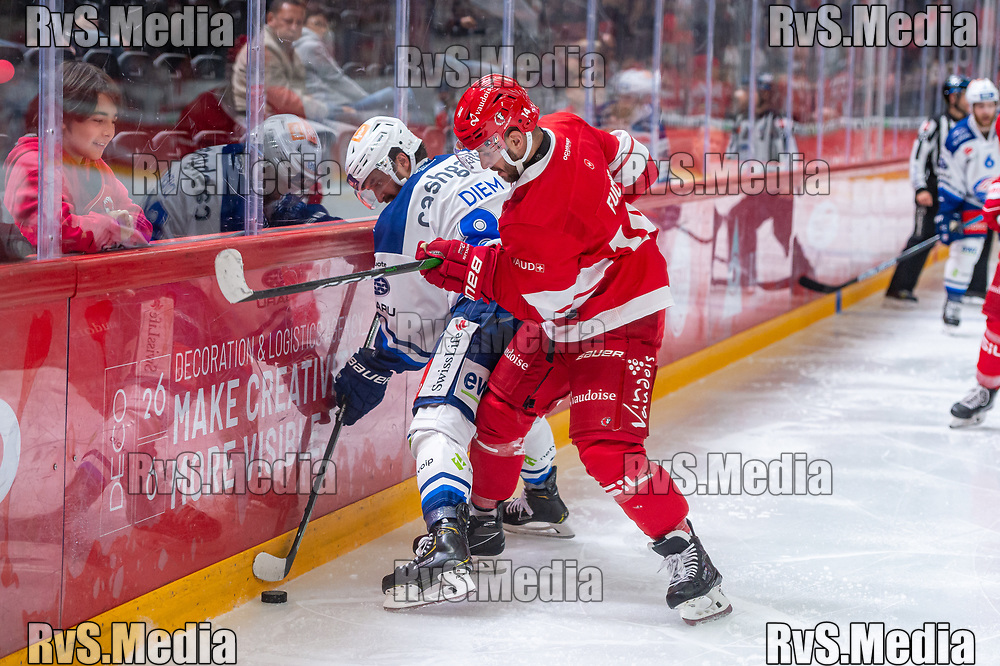 LAUSANNE, SWITZERLAND - OCTOBER 01: Dominik Diem #89 of ZSC Lions battles for the puck with Jason Fuchs #14 of Lausanne HC during the Swiss National League game between Lausanne HC and ZSC Lions at Vaudoise Arena on October 1, 2021 in Lausanne, Switzerland. (Photo by Monika Majer/RvS.Media)