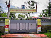 12 JUNE 2013 - YANGON, MYANMAR:    The gate to the compound and family of Aung San Suu Kyi, Myanmar's democracy icon.      PHOTO BY JACK KURTZ