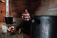 Woman cooking, in the caracol kitchen the beans and coffee are always on the fire.<br /> Mujer cocinando. En el caracol los frijoles y el café están siempre en el  fuego.