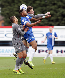 Peterborough United's Britt Assombalonga battles in the air with Rotherham United's Lee Frecklington and James Tavernier - Photo mandatory by-line: Joe Dent/JMP - Mobile: 07966 386802 22/03/2014 - SPORT - FOOTBALL - Peterborough - London Road Stadium - Peterborough United v Rotherham United - Sky Bet League One