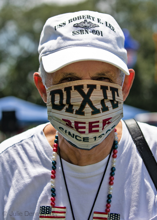 """Man protesting Gail Benson's move to change the name of Dixie Beer at a """"Save America Rally"""" in Baton Rouge on the 4th of July across the street from the Governor's Mansion where about 200 gathered. The 4th of July rally was organized by Jeff Crouer, Mimi Owens and Woody Jenkins, chairman of the executive committee for the Republican Party in East Baton Rouge Parish. Rev. Tony Spell of Life Tabernacle Church who has held church services in defiance of a stay-at-home order throughout the pandemic was one of the speakers. He an other speakers expressed their displeasure of being told to wear a mask to prevent the spread of Covid-19 and the removal of confederate monuments."""