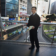A Jehovah witness member hands out Awake magazine to passers by in the morning rush hour.  7 million people live on 1,104km square, making it Hong Kong the most vertical city in the world.
