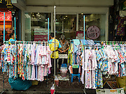 23 DECEMBER 2015 - BANGKOK, THAILAND: A stand selling children's clothing in Banglamphu Market.  Banglamphu Market (also spelled Bang Lamphu) is close to Bangkok's backpacker haunts of Khao San Road. The market is a popular place for knock off designer clothes and street food. The market is an informal collection of street stalls and sidewalk vendors. Bangkok city officials have plans to evict the vendors, close the market and gentrify the neighborhood. This would follow closing similar markets on Maharat Road and Saphan Lek.       PHOTO BY JACK KURTZ