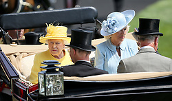 Queen Elizabeth II (left) and The Duchess of Cornwall arriving with The Prince of Wales (right) and Lord Fellowes during day two of Royal Ascot at Ascot Racecourse.