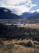The braided Waimakariri River flows towards the Savannah and Puketeraki mountain ranges. New Zealand