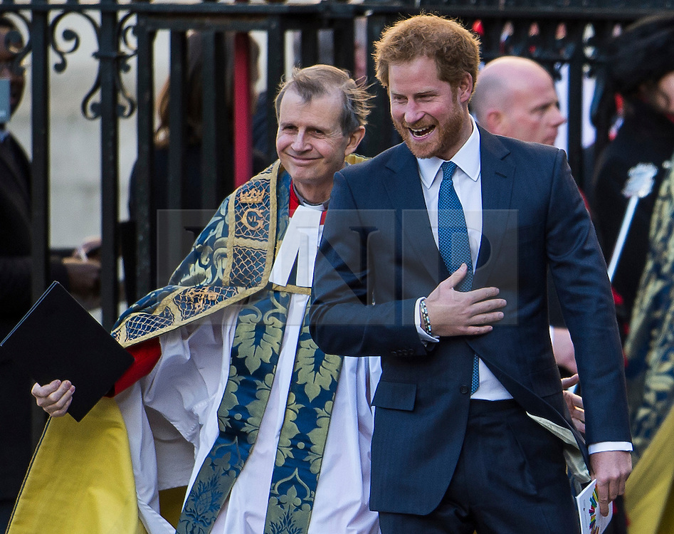 © Licensed to London News Pictures. 14/03/2016. London, UK. PRINCE HARRY laughing as he leaves Westminster Abbey in London after attending a service to mark Commonwealth Day 2016.  Photo credit: Ben Cawthra/LNP