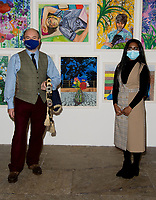 Naveena and Professor Callum atthe Tate Liverpool exhibition of Liverpool NHS worker portraits by Aliza Nisenbaum  the exhibition celebrates Merseyside NHS workers=