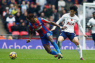 Wilfried Zaha of Crystal Palace (L) dispossesses Son Heung-min of Tottenham Hotspur (R). Premier league match, Tottenham Hotspur v Crystal Palace at Wembley Stadium in London on Sunday 5th November 2017.<br /> pic by Steffan Bowen, Andrew Orchard sports photography.