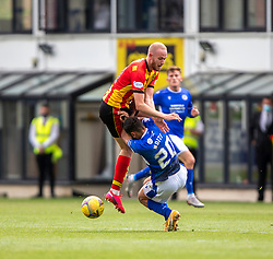 31JUL21 Partick Thistle's Zak Rudden and Queen of the South's Roberto Nditi. Partick Thistle 3 v 2 Queen of the South. First Scottish Championship game of the season.
