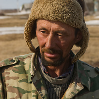 A nomadic Komi reindeer herder waits outside of Snopa village while his companions buy supplies.