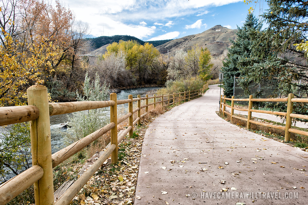 A walking path runs along the edge of Clear Creek in Golden, Colorado, just outside Denver at the eastern edge of the Rocky Mountains.