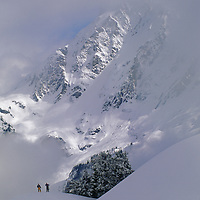 Powder skiers head out-of-bounds under Mount Shuksan.