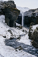 Kvernufoss waterfall in winter, South Iceland.