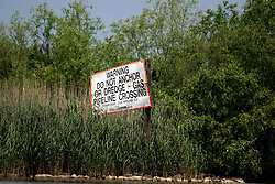 05 May 2010. Venice, Louisiana. Deepwater Horizon, British Petroleum environmental oil spill disaster.<br /> Gas and oil pipelines already criss-cross and decimate much of Louisiana's wetlands statewide. For decades environmentalists have complained that the channeling of such pipelines through the wetlands has done nothing but permit salt water to intrude upon fresh water, killing hundreds of thousands of acres of wetland. During hurricanes salt water is funneled into the marshes by the oil and gas channels slashing through the wetlands. The oil and gas industry has for the most part ignored the accusation, focusing instead on adding more such pipelines.<br /> Photo credit; Charlie Varley/varleypix.com