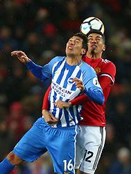Brighton & Hove Albion's Leonardo Ulloa (left) and Manchester United's Chris Smalling battle for the ball