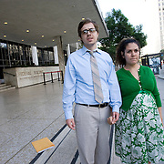 Eric Stauth and his wife, Alma, wait outside the Los Angeles Federal Building where Alma was to appear at a deportation hearing at the Department of Homeland Security. Alma is an undocumented immigrant who was brought here as a toddler. The couple, expecting their first child, waiting nervously outside until hearing from her lawyer for fear the she would be immediately deported. Please contact Todd Bigelow directly with your licensing requests.