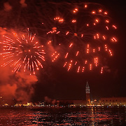 VENICE, ITALY - DECEMBER 31:   Fireworks display are seen in St. Mark's Square from S Giorgio during New Year's Eve street party on December 31, 2011 in Venice, Italy.  Official figures say that around seventy thousand people gathered in St. Mark Square for this year's street celebrations.