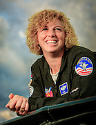 U.S. Air Force Colonel Jill Long has been a aerial refuling tanker pilot, flown an A-10 Warthog on over 50 combat missions in Afghanistan, and has been a squadron commander in Germany.  In her spare tiime, she flies a Pitts S2B doing aerobatic routines at airshows across the country.  Photographed for Women In Aviation during Airventure 2009, in Oshkosh, Wisconsin.  <br /> <br /> Created by aviation photographer John Slemp of Aerographs Aviation Photography. Clients include Goodyear Aviation Tires, Phillips 66 Aviation Fuels, Smithsonian Air & Space magazine, and The Lindbergh Foundation.  Specialising in high end commercial aviation photography and the supply of aviation stock photography for advertising, corporate, and editorial use.