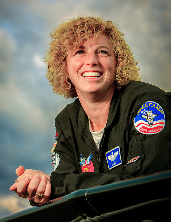 U.S. Air Force Colonel Jill Long has been a aerial refuling tanker pilot, flown an A-10 Warthog on over 50 combat missions in Afghanistan, and has been a squadron commander in Germany.  In her spare tiime, she flies a Pitts S2B doing aerobatic routines at airshows across the country.  Photographed for Women In Aviation during Airventure 2009, in Oshkosh, Wisconsin.  <br />