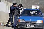 Kosovo, Pristina, Graçanica – Kishnicë<br /> Sunday, March 2, 2008<br /> <br /> <br /> At the entrance of Graçanica township, Kosovo Police Service, Special Police UNIT, (KPS-SPU) has organize a control check point, in which they use to stop every suspiciously vehicle with plates from Serbia.<br /> PICTURED:<br /> Suspicious vehicle's driver with plates from Serbia is controlling in details from KPS-SPU <br /> <br /> VEDAT xhymshiti/ZUMApress photojournalist