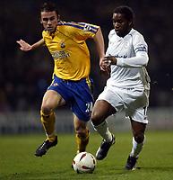 Photo. Aidan Ellis.<br />Bolton Wanderers v Southampton.<br />Carling Cup Quater Final.<br />16/12/2003.<br />Bolton's Jay-Jay Okocha and Southampton's David Prutton