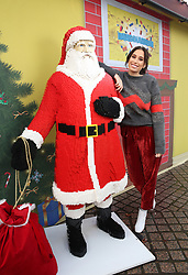 EDITORIAL USE ONLY Stacey Solomon with a model of Santa Claus at the LEGO Imaginarium, which is open for this weekend only on London's Southbank.