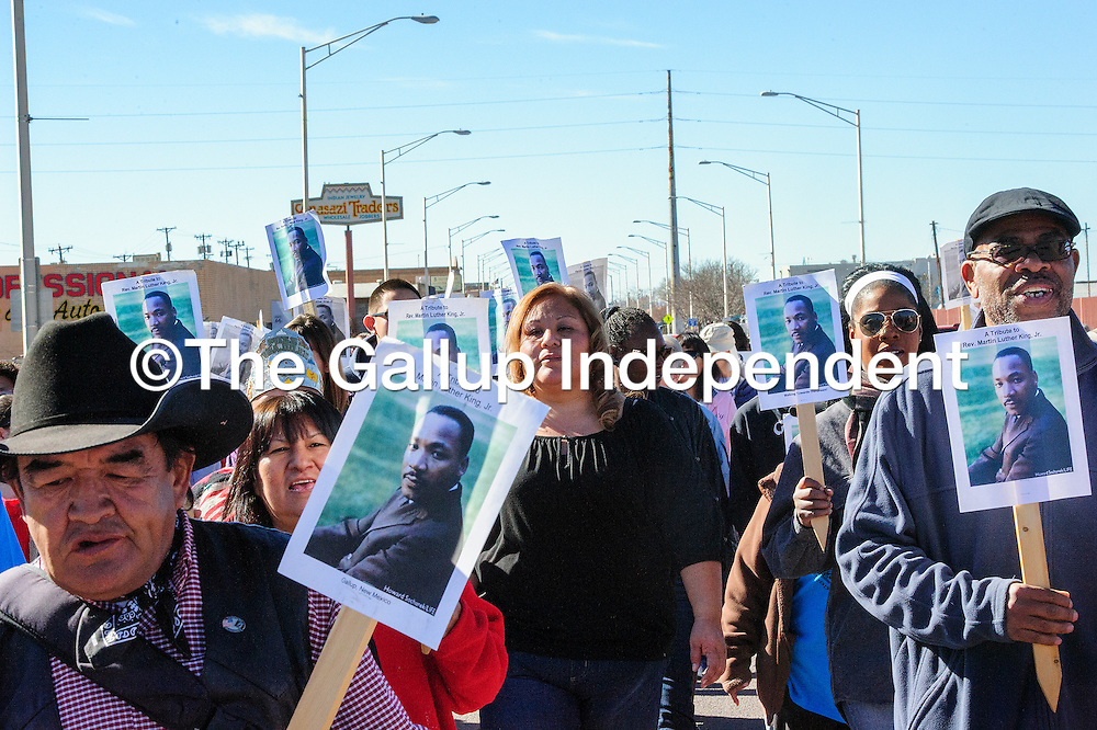 012014  Adron Gardner/Independent<br /> <br /> Many faces of Gallup march east on on Historic Route 66 to commemorate Martin Luther King Day in Gallup Monday.