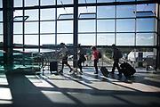 Commuters heading towards their fights from the Metro in Copenhagen Airport, Copenhagen, Denmark 21st of August 2016.