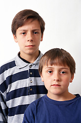 Portrait of two young boys looking serious,