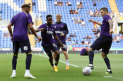Derby County's Florian Jozefzoon (second left) warms up before the Sky Bet Championship match at the Madejski Stadium, Reading.