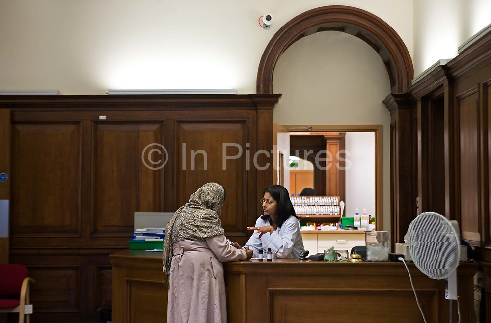 Awaiting perscriptions in pharmacy at the London Homeopathic Hospital on 3rd December 2005 in London, United Kingdom.  Part of University College London Hospitals NHS Foundation Trust, it is the largest public sector provider of complementary medicine in Europe. From 3 April 2018, the hospital stopped providing NHS-funded homeopathic remedies for any patients as part of their routine care after health service chiefs said homeopathy was at best, a placebo.
