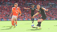 Lincoln City's Anthony Scully crosses the ball despite the attentions of Blackpool's Oliver Turton<br /> <br /> Photographer Chris Vaughan/CameraSport<br /> <br /> The EFL Sky Bet League One Play-Off Final - Blackpool v Lincoln City - Sunday 30th May 2021 - Wembley Stadium - London<br /> <br /> World Copyright © 2021 CameraSport. All rights reserved. 43 Linden Ave. Countesthorpe. Leicester. England. LE8 5PG - Tel: +44 (0) 116 277 4147 - admin@camerasport.com - www.camerasport.com