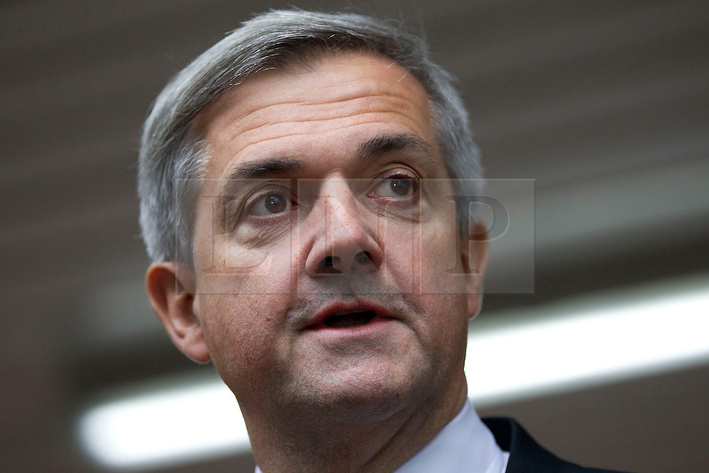 © Licensed to London News Pictures. 04/02/2013. London, UK. Former Cabinet minister Chris Huhne is seen delivering a statement, in which he announced his resignation as a member of parliament, to the press outside Southwark Crown Court in London today (04/02/2013) after pleading guilty to perverting the course of justice in conjunction with a 2003 speeding case. Photo credit: Matt Cetti-Roberts/LNP