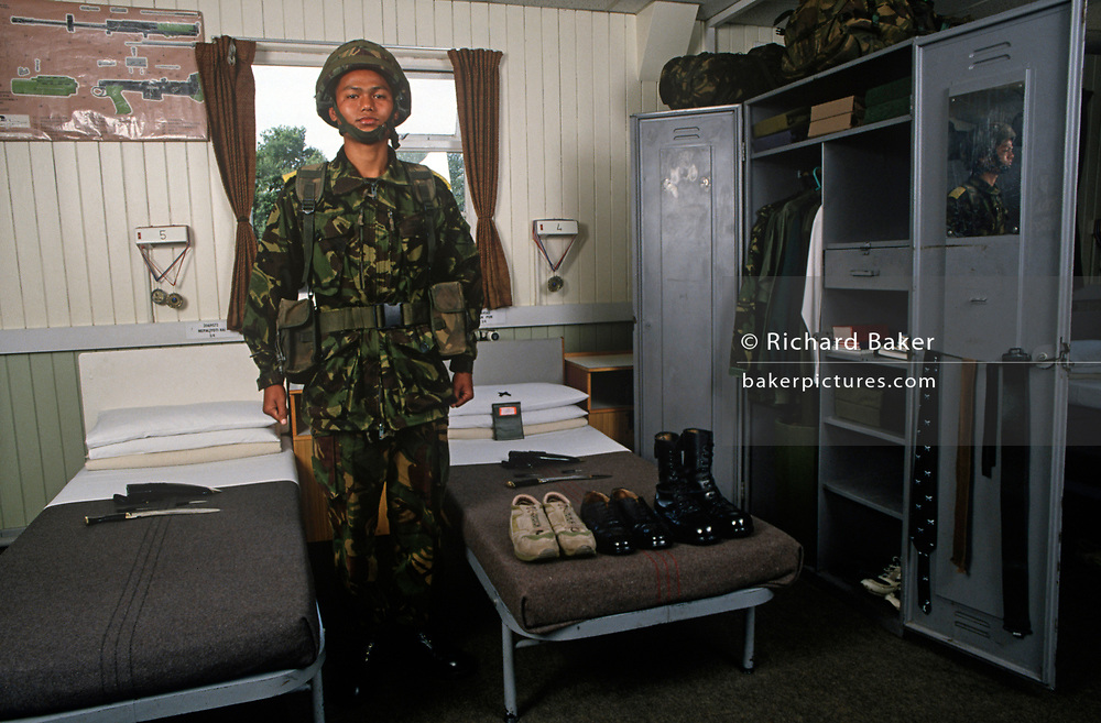 A British Army Gurkha recruit stands to attention during a barracks inspection at the Gurkha Regiment's training centre at Church Crookham, on 16th January 1996, in England UK. Some 60,000 young Nepalese boys aged between 17 - 22 (or 25 for those educated enough to become clerks or communications specialists) report to designated recruiting stations in Nepal's Himalayan foothills each November, most living from altitudes ranging from 4,000 - 12,000 feet. Only 160 are recruited with training continuing at this barracks until joining various units within the army. The Gurkhas training wing in Nepal has been supplying youth for the British army since the Indian Mutiny of 1857. (Photo by Richard Baker / In Pictures via Getty Images)