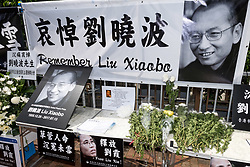 July 14, 2017 - Hong Kong, Hong Kong SAR, China - What had been the site of a sit-in protest to free Liu today became the site of remembrance.Following the death in China of Liu Xiaobo, the Nobel peace laureate, the protest outside the Liaison Office of the Central People's Government in the Hong Kong Special Administrative Region remains in place with books of condolences available to sign. (Credit Image: © Jayne Russell via ZUMA Wire)