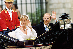 Sophie Rhys-Jones and Prince Edward wave to the crowd after getting married at St George's Chapel at Windsor Castle. The Royal couple, who met in 1993 in London at a charity tennis match organised by the Prince, will hereafter be known as the Earl and Countess of Wessex.