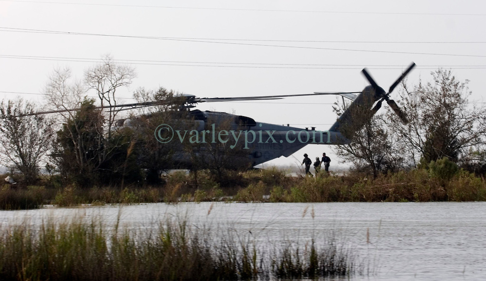 25 Sept, 2005.  Lake calcasieu, Louisiana. Hurricane Rita aftermath. <br /> A military helicopter drops FEMA officials close to the bridge connecting Hackberry one day after the storm.<br /> Photo; ©Charlie Varley/varleypix.com