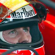 Ferrari driver Michael Schumacher concentrates on his times