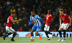 Brighton & Hove Albion's Jurgen Locadia gets through the Manchester United midfield