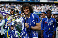 Chelsea Defender David Luiz (30) celebrates with the trophy during the Premier League match between Chelsea and Sunderland at Stamford Bridge, London, England on 21 May 2017. Photo by Andy Walter.