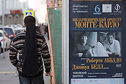 Moscow, Russia, 26/04/2011..A music student walks past a concert advertising poster in front of the Moscow Conservatory.