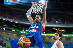 Alexis Ajinca #14 of France dunks during basketball match between national team of Serbia and France of Eurobasket 2013 on September 15, 2013 in SRC Stozice, Ljubljana, Slovenia. (Photo By Matic Klansek Velej / Sportida.com)