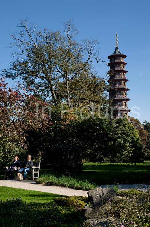 The Pagoda at Kew Gardens in the autumn, London. In the South East corner of Kew Gardens stands the Great Pagoda (by Sir William Chambers), erected in 1762, from a design in imitation of the Chinese Ta. From the base to the highest point is 50m. The Royal Botanic Gardens, Kew, usually referred to simply as Kew Gardens, are 121 hectares of gardens  and botanical glasshouses between Richmond and Kew in southwest London, England. It is an internationally important botanical research and education institution with 700 staff, receiving around 2 million visitors per year.