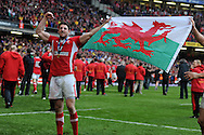 Alex Cuthbert of Wales celebrates after the Welsh win.  RBS Six nations championship 2012, Wales v France at the Millennium Stadium in Cardiff, South Wales on Saturday 17th March 2012.  pic by Andrew Orchard, Andrew Orchard sports photography,