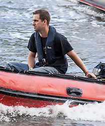 © Licensed to London News Pictures. 15/06/2016. London, UK. Brendan Cox , husband of Labour MP Jo Cox, drives an 'IN' campaign protest boat as Nigel Farage leads a flotilla of pro-Brexit fishing boats down the River Thames. Jo Cox MP died on Thursday 16 June 2016 after being shot and stabbed in Birstall, Leeds. Her husband has urged people to 'fight against the hatred' that killed his wife. Photo credit: Rob Pinney/LNP