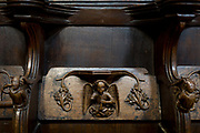 A detail of intricate wooden carvings in the choir of St. Laurences Church, Ludlow, on 11th September 2018, in Ludlow, Shropshire, England UK.